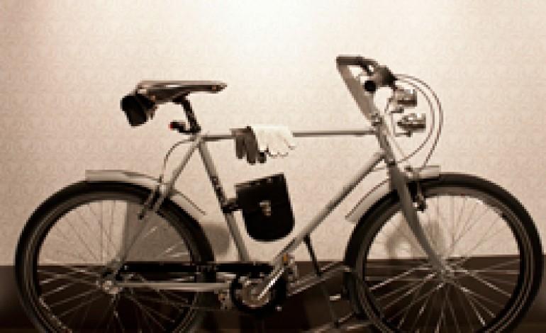 Pineider sale in bicicletta con Olmo