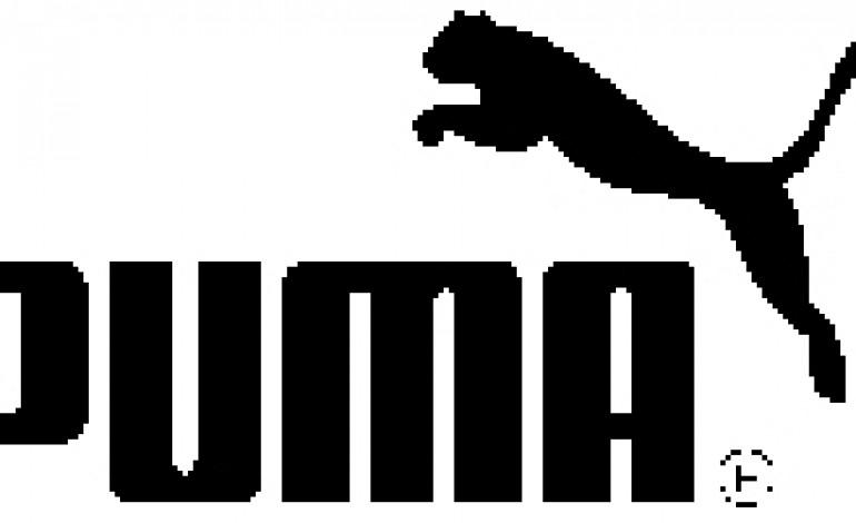 Il dollaro taglierà gli utili 2015 di Puma